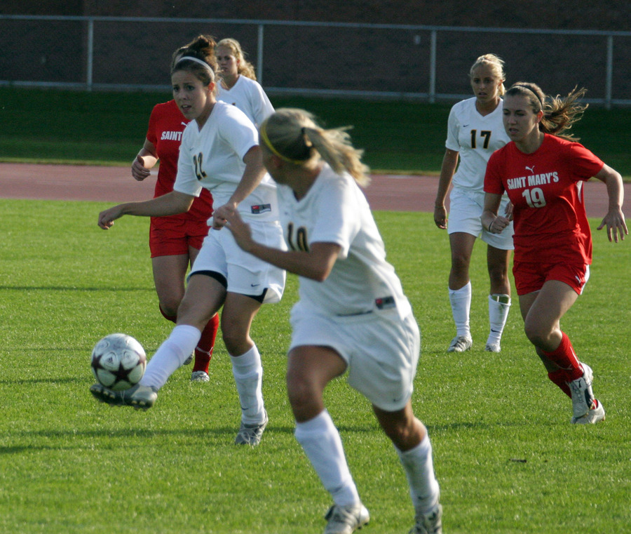 Megan Zenner sends a through ball to forward Ashley Anderson