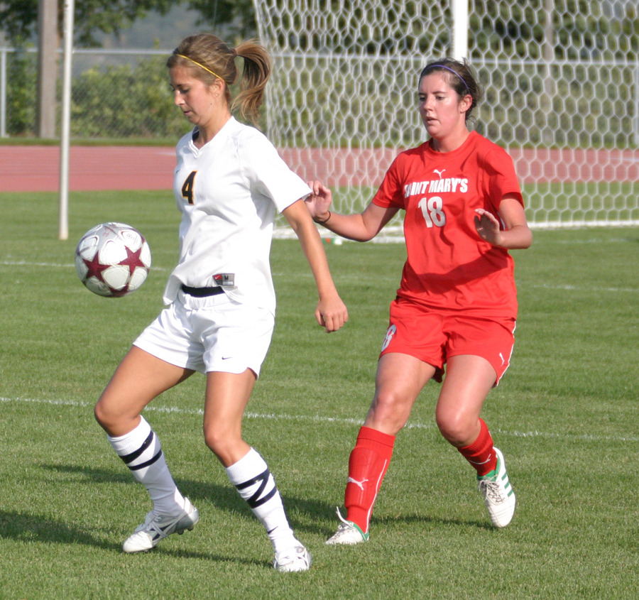Becca Hagen traps the ball in front of a Cardinal defender.