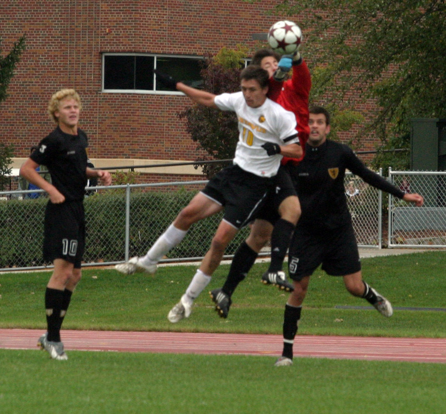 Bret VanderStreek goes up high for a header in front of the St. Olaf net.