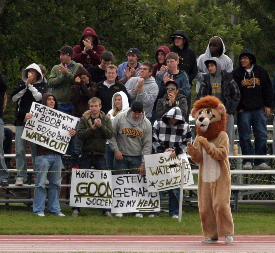 The Gustavus student section cheers on a cold and wet day at the Gustie soccer pitch.