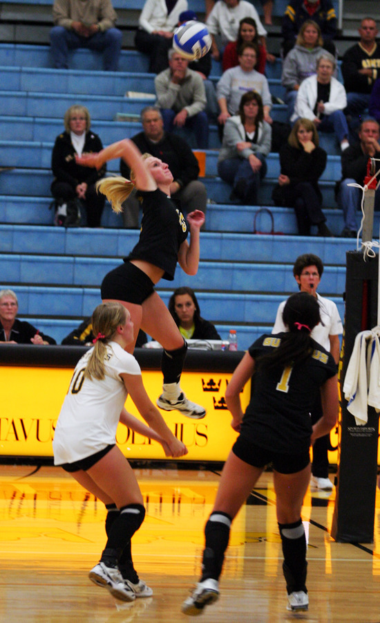 Olivia Warren goes up high for a kill.
