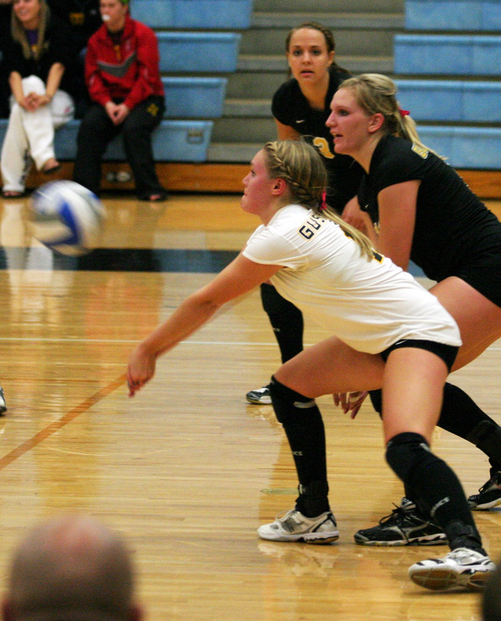 Libero Erin Sherman digs a St. Catherine kill attempt.