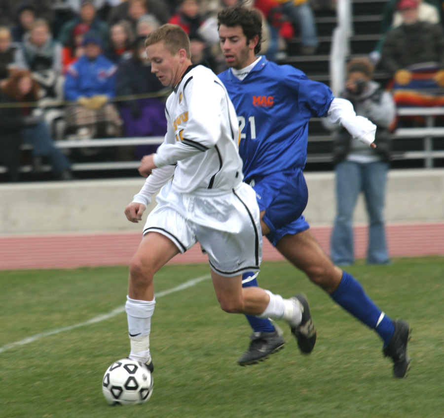 Bobby Kroog dribbles up field in last year's match at home versus Macalester.
