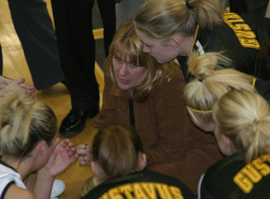 Coach Haller meets with her team during a timeout