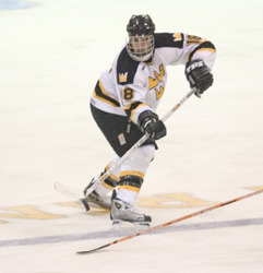Defenseman Adam Meyer puts the puck in play for the Gusties