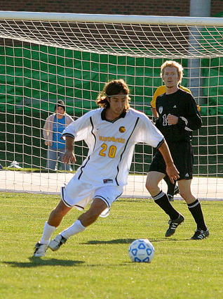 #20 Jon Astry dribbles away from the Warhawk defender.