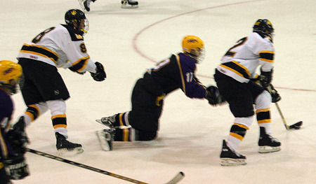 Reegan Rehm keeps the puck away from a Pointer defender.