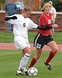 #6 Amy Larson avoids a defender