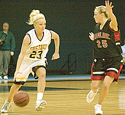 Lacy Skoog take the ball upcourt for the Gusties