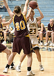 Lacy Skoog looks for a shot over a Cobber defender