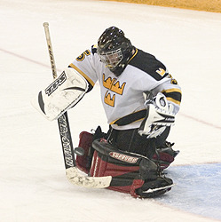 Gustie goaltender Scott Witkowski makes one of his 28 saves on Saturday.