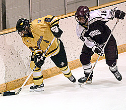 Tanna Tuomie works the puck along the boards in the first period.