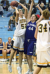 Bri Monahan shoots over a Tommie defender