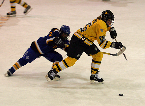 Margaret Dorner battles for control of the puck in the Gustie defensive zone.