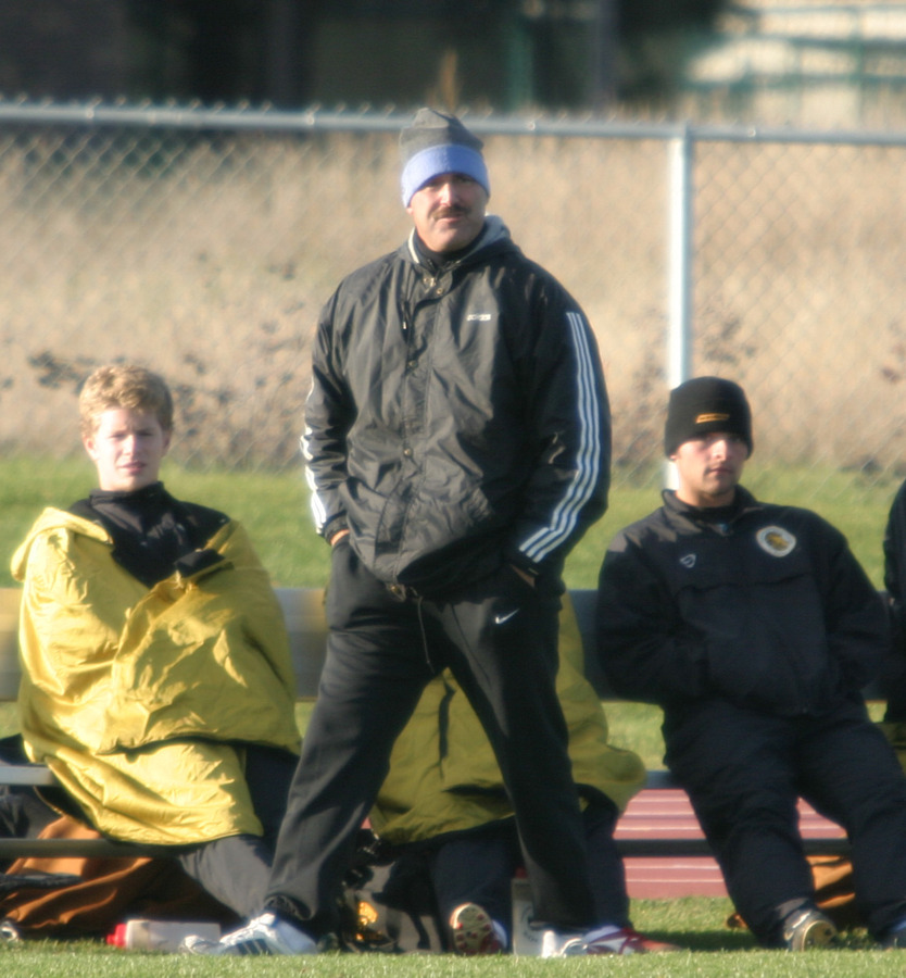 Coach Zelenz walks the sidelines during one of the home matches this past fall.