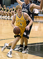 Doug Espenson drives the lane for the Gusties.