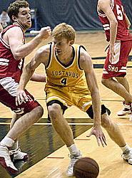 Doug Espenson drives for two of his 16 points against the Cardinals.