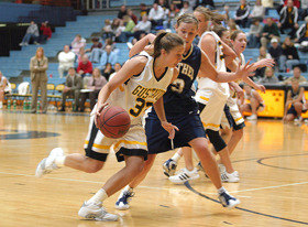 Kenzie Consoer handles the ball for the Gusties