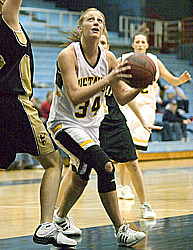 Erin Boese scores two of her 14 points for the Gusties