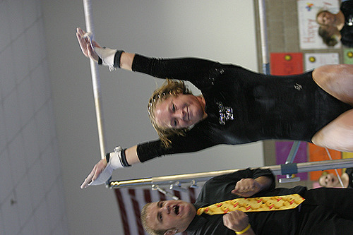 Therese Gay finishes a strong routine on the uneven bars.