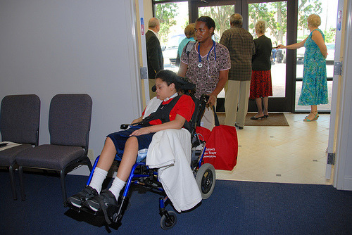 Nurse with Child in Wheelchair